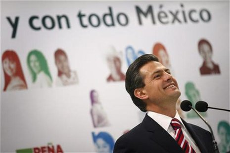 Enrique Pena Nieto, presidential candidate for the opposition Institutional Revolutionary Party (PRI), smiles during a news conference in Me