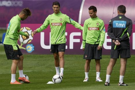 Portugal's Cristiano Ronaldo (2nd L) attends a training session for the Euro 2012 soccer tournament at a training field in Opalenica June 11
