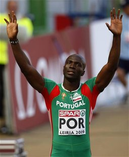 Portugal's Francis Obikwelu salutes the public after winning Heat 2 of the 100 meters at the European Team Championship in Leiria city stadi