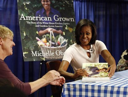 "U.S. first lady Michelle Obama attends a book signing of her first book ""American Grown"" at a book store in Washington, June 12, 2012. REUTE"