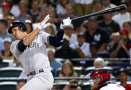 New York Yankees Alex Rodriguez hits a grand slam to tie the game in the eighth inning of play against the Atlanta Braves at their MLB Inter