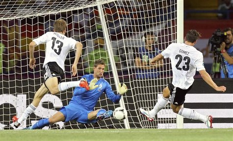 REFILE - CORRECTING BYLINE Germany's Mario Gomez (R) scores a goal against Netherlands during their Group B Euro 2012 soccer match at the Me