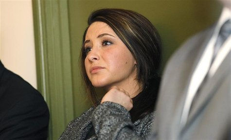 Bristol Palin watches while her mother former Alaska governor Sarah Palin delivers her keynote speech at the Reagan 100 opening banquet at t