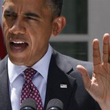 U.S. President Barack Obama responds to a reporter's questions as he speaks about immigration from the Rose Garden of the White House in Was