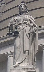 Lady Justice holds the Scales of Justice