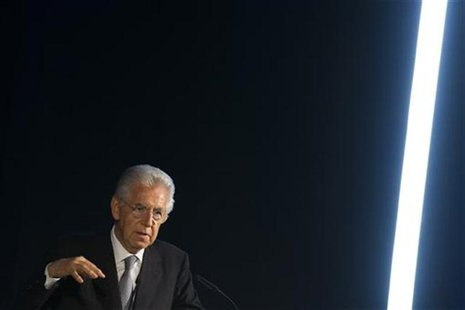 Italian Prime Minister Mario Monti delivers a speech before receiving the ESMT Responsible Leadership Award during the annual forum of the E