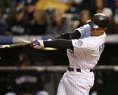 Colorado Rockies OG Carlos Gonzalez broke his bat in this 2010 photo, but he broke the Tigers on June 15, 2012, as his three-run homer highlighted an eight-run 10th inning in the Rox' 12-4 thumping of Detroit at Comerica Park. REUTERS/Rick Wilking