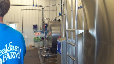 The two tanks where the milk is stored until its loaded on a truck and taken to a dairy. .
