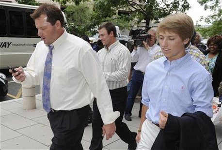 Former MLB baseball pitcher Roger Clemens (L) departs the courthouse with family members and his defense team after the end of closing argum