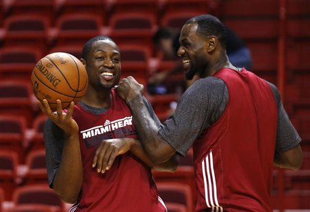 Miami Heat's Dwyane Wade (L) and LeBron James (R) joke around during a team practice for the NBA basketball finals in Miami June 18, 2012. H