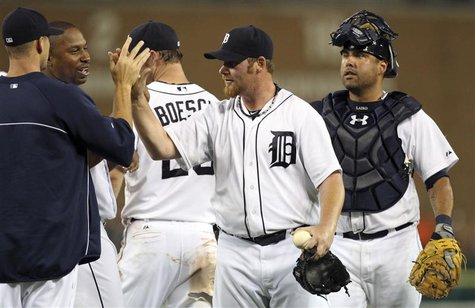 Detroit Tigers closer pitcher Phil Coke (2nd R) and catcher Gerald Laird (R) celebrate with teammates after their victory over the Saint Lou