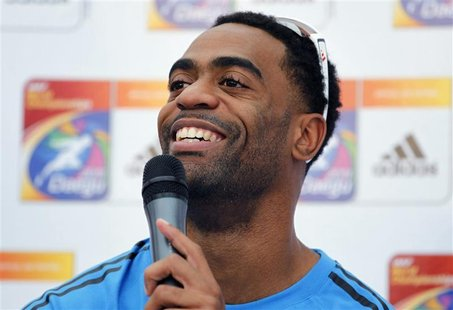 EUGENE, Oregon (Reuters) - Tyson Gay expects a dog fight in the men's 100 ...