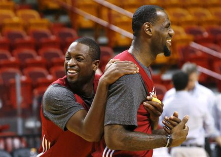 Miami Heat players Dwyane Wade (L) and LeBron James (R) joke around during a team practice at the NBA basketball finals in Miami June 20, 20