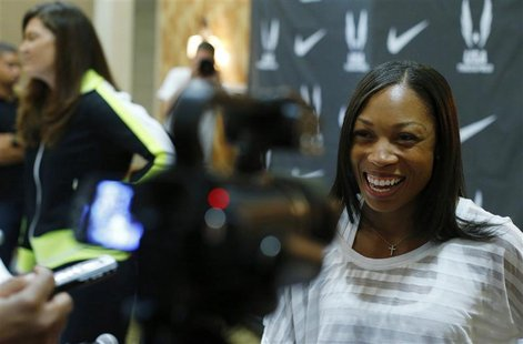 Sprinter Allyson Felix answers a reporter's question following a news conference at the U.S. Olympic athletics trials in Eugene, Oregon June