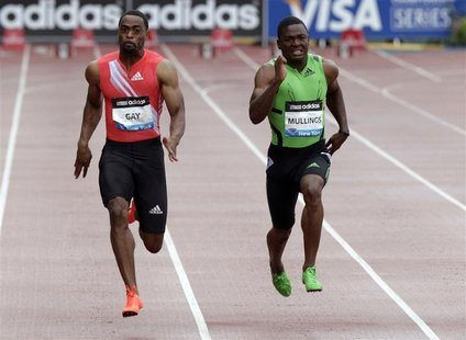 Jamaican sprinter Steve Mullings (R) competes against Tyson Gay of the U.S. in the men's 100-metre race at the New York Diamond League Grand