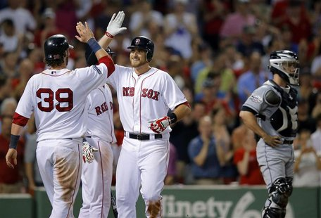 Boston Red Sox Jarrod Saltalamacchia (39) and Will Middlebrooks (C) celebrate beside Miami Marlins catcher Brett Hayes after scoring on Midd