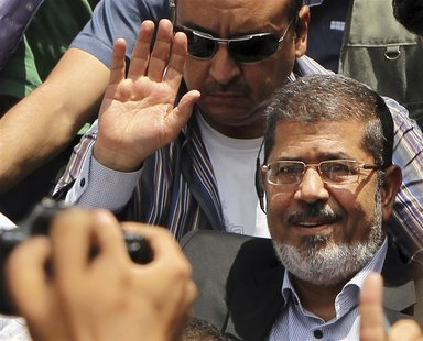 Mohamed Morsy waves to his supporters after Friday prayers in Cairo in this June 22, 2012 file photo. REUTERS/Suhaib Salem/Files