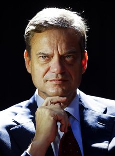 Former European Central Bank executive board member Lorenzo Bini Smaghi poses during a portrait session in the garden at his home in Rome in