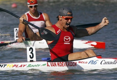 Adam Van Koeverden (front) of Canada celebrates winning the men's K1 1000m final during the ICF Canoe and Kayak Sprint World Championships i