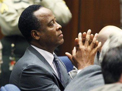 Dr. Conrad Murray sits in court after he was sentenced to four years in county jail for his involuntary manslaughter conviction of pop star