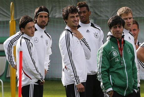 Germany's national soccer players Mesut Oezil, Sami Khedira, Mats Hummels, Jerome Boateng, coach Joachim Loew, Holger Badstuber and Mario Go