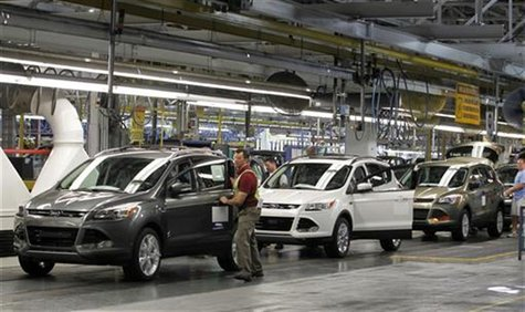 Louisville Assembly Plant employees work to assemble the new 2013 Ford Escape on the production line at the company's newly transformed Loui