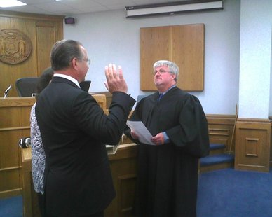 Judge Mike Moran delivers the oath of office to Republican State Senator Jerry Petrowski, June 26 2012