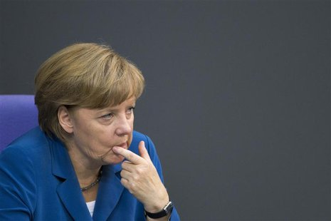 German Chancellor Angela Merkel gestures after she delivers a government policy statement at the lower house of parliament, the Bundestag, i