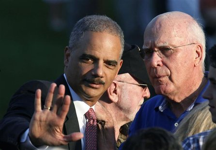 U.S. Attorney General Eric Holder (L) and Chairman of the Senate Judiciary Committee Sen. Patrick Leahy talk on the South Lawn of the White