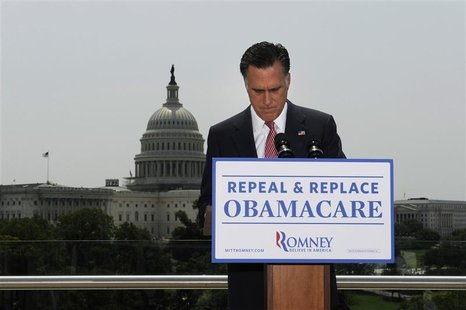 U.S. Republican Presidential candidate Mitt Romney pauses as he gives his reaction to the Supreme Court's upholding key parts of President B