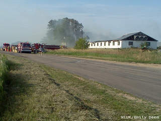 Firefighters battle a barn fire on Pioneer Road in the Manitowoc County town of Meeme, June 29, 2012. (courtesy of FOX 11).