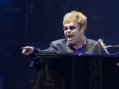 Singer Elton John performs at a charity concert dedicated to the fight against HIV/AIDS at Independence Square in Kiev June 30, 2012. REUTER