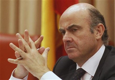 Spain's Economy Minister Luis de Guindos listens to a question during a parliamentary hearing at the Spanish parliament in Madrid June 26, 2
