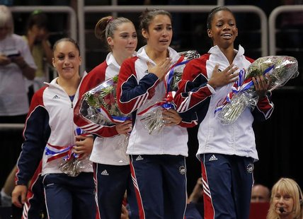 U.S. gymnasts Jordyn Wieber, McKayla Maroney, Alexandra Raisman and Gabrielle Douglas (L-R) cry as they are introduced as members of the U.S
