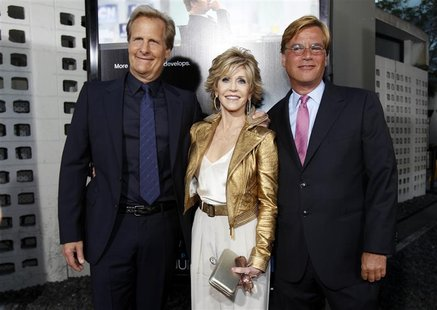 Creator and executive producer Aaron Sorkin (R) poses with cast members Jane Fonda and Jeff Daniels at the premiere of the HBO television se