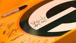 Green Bay Mayor Jim Schmitt and Packers President and CEO Mark Murphy are among the signatures on the steel beam. (courtesy of FOX 11).