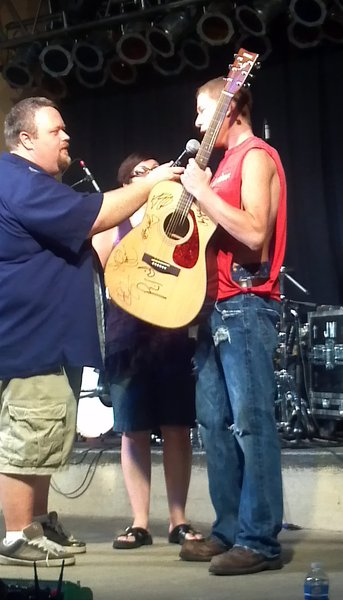 Dylan Raikowski won our autographed guitar