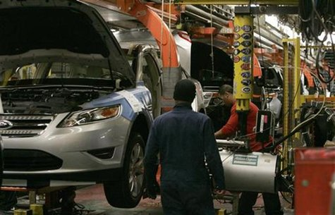 Workers place tires on the 2011 Ford Explorer and other vehicles at the Ford assembly plant in Chicago, Illinois, December 1, 2010. REUTERS/