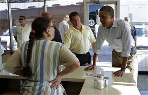 U.S. President Barack Obama (R) places his breakfast order during a visit to Ann's Restaurant in Akron, Ohio July 6, 2012. REUTERS/Kevin Lam