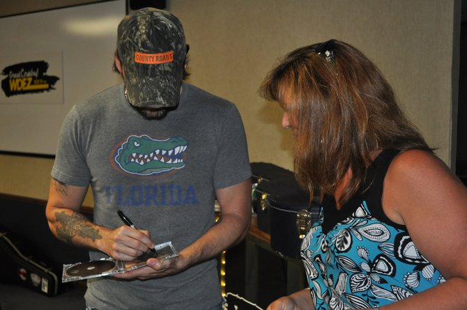 Rick Monroe signs CDs for listeners