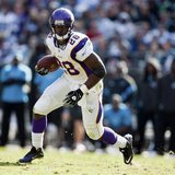 Minnesota Vikings' running back Adrian Peterson (28) runs the ball against the Carolina Panthers during an NFL football game in Charlotte, N