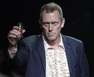 British singer and actor Hugh Laurie greets the audience before his performance at the 46th Montreux Jazz Festival in Montreux July 9, 2012.