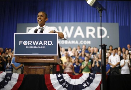 U.S. President Barack Obama speaks during an event on extending the Bush-era tax cuts for middle class families at Kirkwood Community Colleg