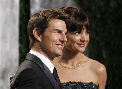 Actor Tom Cruise and his wife, actress Katie Holmes, arrive at the 2012 Vanity Fair Oscar party in West Hollywood, California February 26, 2