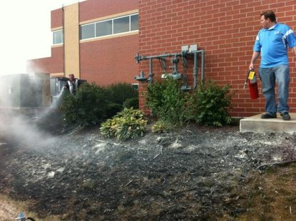 A grass fire started at Midwest Communications studios Friday afternoon in Bellevue.