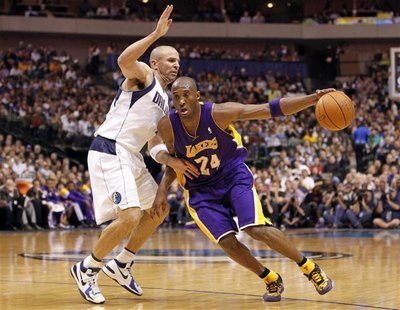 Los Angeles Lakers guard Kobe Bryant (R) drives past Dallas Mavericks guard Jason Kidd during the second half of their NBA basketball game i