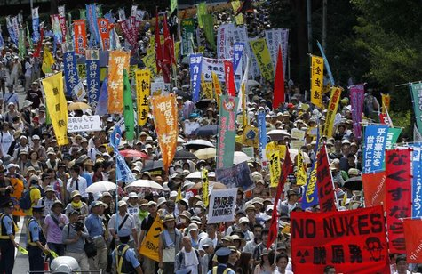 Protesters march during an anti-nuclear demonstration demanding a stop to the operation of nuclear power operations in Tokyo July 16, 2012.