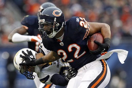 Chicago Bears running back Matt Forte (R) is brought down by San Diego Chargers' Steve Gregory (L) in the first half of their NFL football g