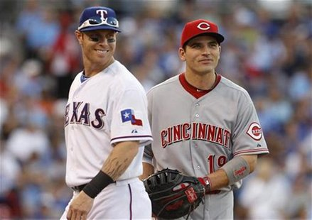 American League All-Star Josh Hamilton (L) of the Texas Rangers speaks with National League All-Star Joey Votto of the Cincinnati Reds durin