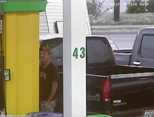 Surveillance photo of a man suspected of stealing a truck in Oshkosh, then being involved in gas drive-offs in the Appleton, Fond du Lac and Lomira areas, released July 18, 2012.